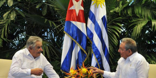 Uruguayan President Jose Mujica (L) speaks with his Cuban counterpart Raul Castro during a meeting at...