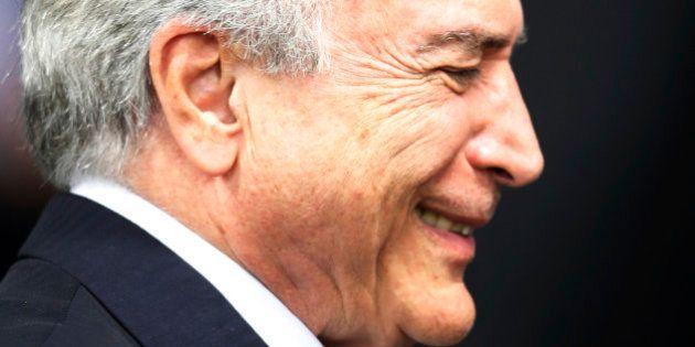 BRASILIA, BRAZIL - MAY 12: Brazil's interim President Michel Temer attends a signing ceremony for new...