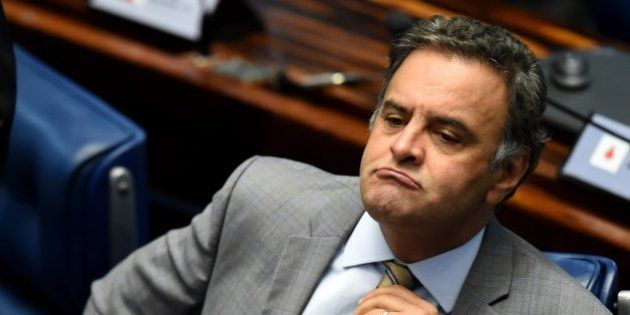 Senator Aecio Neves, who heads the PSDB opposition party, is pictured during a senate's session to form...