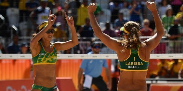 Brazil's Larissa Franca Maestrini and Brazil's Talita Rocha celebrate after defeating Poland's Kinga...