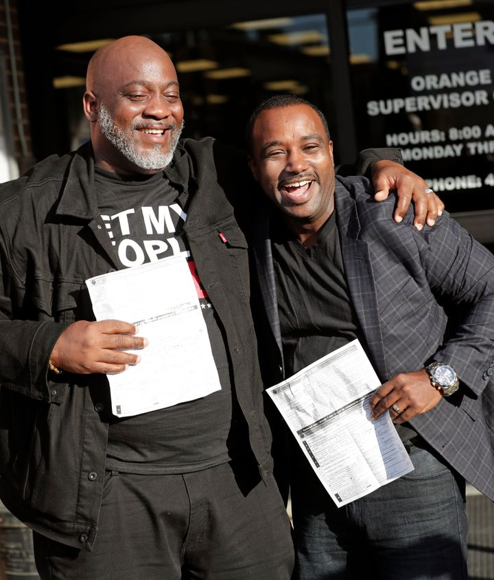 Former felons Desmond Meade, president of the Florida Rights Restoration Coalition, left, and David Ayala, husband of State A
