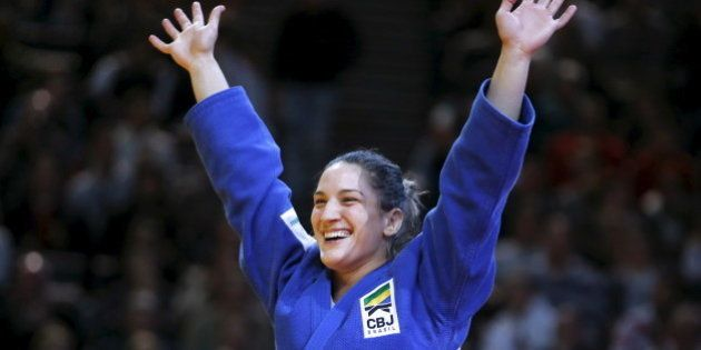 Mayra Aguiar of Brazil reacts after defeating Kayla Harrison of the U.S. in their women's under 78kg...
