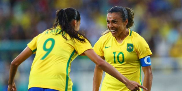 RIO DE JANEIRO, BRAZIL - AUGUST 03: Marta of Brazil (10) celebrates with Andressa Alves as she scores...