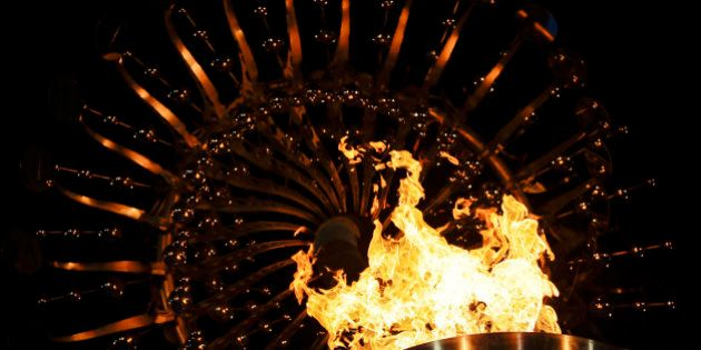 Flames burn in the Olympic cauldron after being lit during the opening ceremony of the 2016 Summer Olympics...