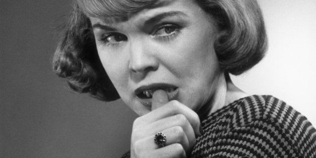 UNITED STATES - CIRCA 1950s:  Woman biting her nail.  (Photo by George Marks/Retrofile/Getty Images)