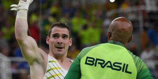 Brazil's Arthur Zanetti reacts after competing in the men's rings event final of the Artistic Gymnastics...