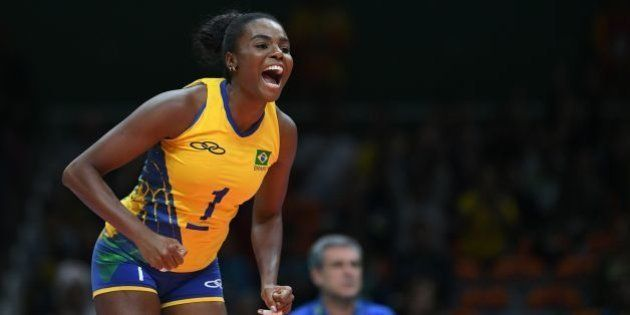 Brazil's Fabiana Claudino celebrates after winning a point during the women's qualifying volleyball match...