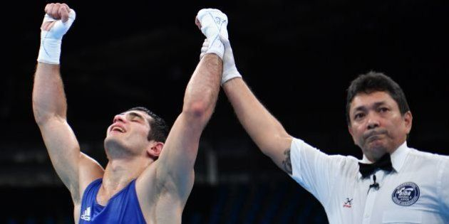 Azerbaijan's Kamran Shakhsuvarly reacts after winning the Men's Middle (75kg) Quarterfinal 2 match against...