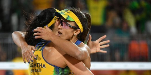 Brazil's Agatha Bednarczuk (L) and Barbara Seixas De Freitas celebrate after winning a point during the...