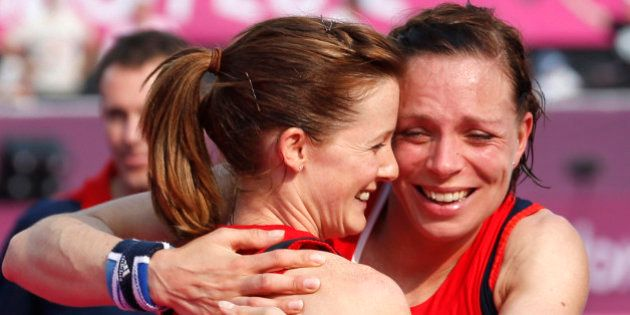 Great Britain's Helen Richardson (2nd L) and Kate Walsh celebrate winning against New Zealand at the...