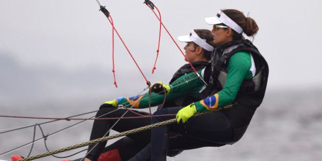 Brazil's competitors in the 49er FX sailing class Martine Grael and Kahena Kunze sail during a training...