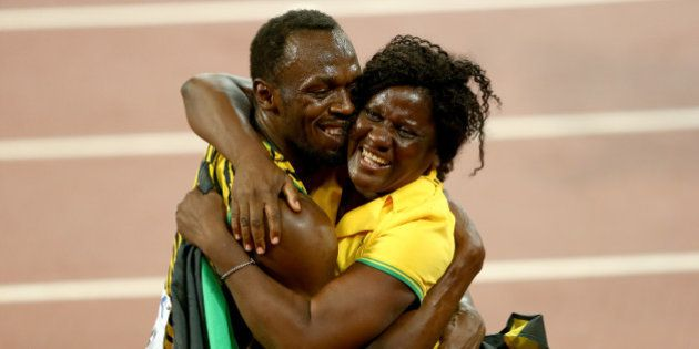 BEIJING, CHINA - AUGUST 23: Usain Bolt of Jamaica celebrates with mother Jennifer Bolt after winning...