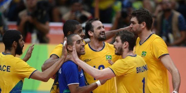 Brazil's Luiz Felipe Marques Fonteles (C) and teammates celebrates after scoring during the men's Gold...