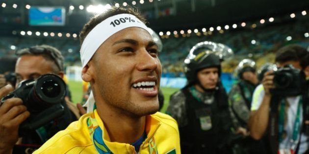 Brazil's forward Neymar celebrates with fans after the Rio 2016 Olympic Games men's football gold medal...