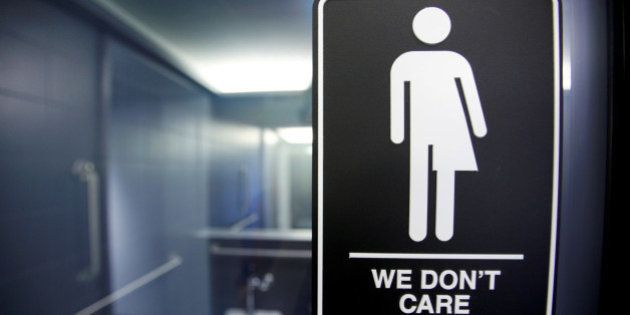 A sign protesting a recent North Carolina law restricting transgender bathroom access is seen in the...