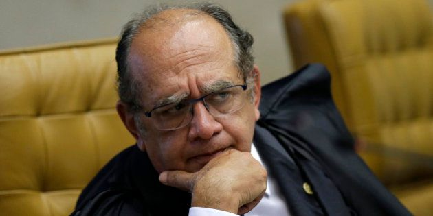 Judge Gilmar Mendes reacts during a session at the Supreme Court in Brasilia March 11, 2015. REUTERS/Ueslei...