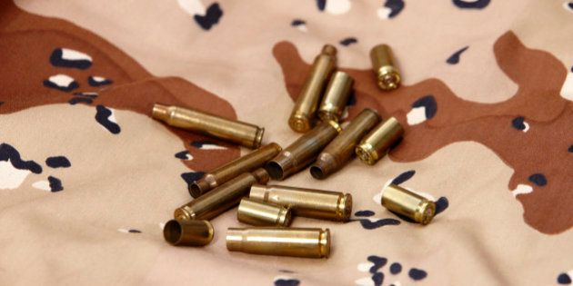 Used shell casings on old persian gulf war desert battle dress