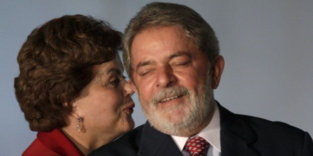 Dilma Rousseff (L), the Brazilian president's Chief of Staff, talks with Brazilian President Luiz Inacio...