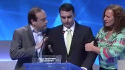 Filho de Bolsonaro passa mal em debate, Feghali tenta ajudar, mas é impedida pelo