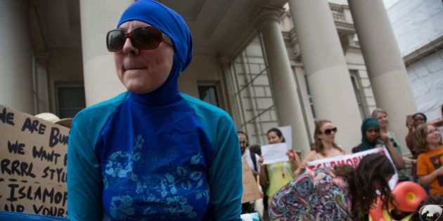 'Wear what you want' protest at the French embassy against the burkini ban for Muslim women on Frances...