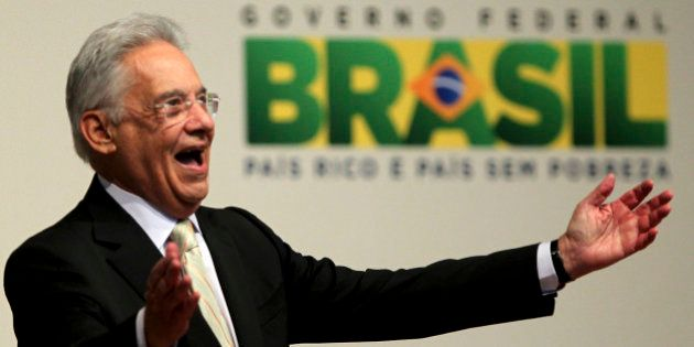 Former Brazilian President Fernando Henrique Cardoso acknowledges the crowd in Sao Paulo August 18, 2011....