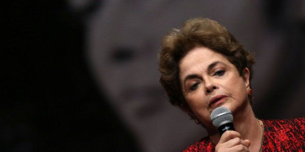 Brazil's suspended President Dilma Rousseff speaks during a meeting with people from pro-democracy movements...