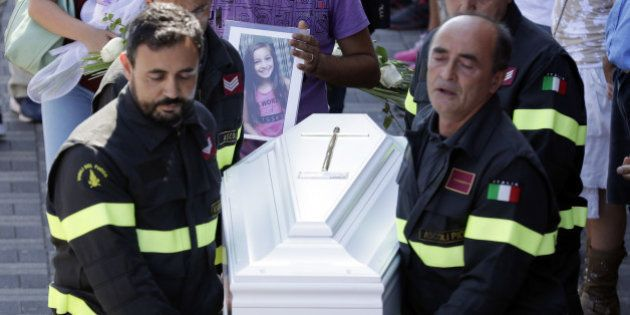 The coffin of 9-year-old Giulia Rinaldo, is carried outside the gymnasium at the end of the state funeral...