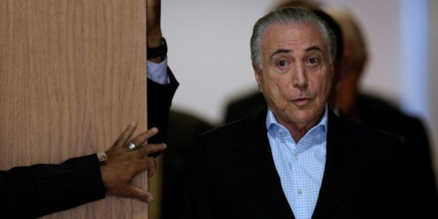 Brazil's President Michel Temer arrives to a news conference at the Planalto Palace in Brasilia, Brazil,...