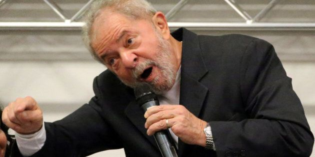 Brazil's former President Luiz Inacio Lula da Silva gestures as he attends a national conference of bank...