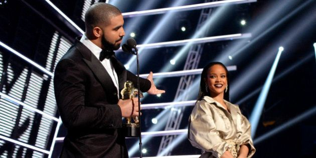 NEW YORK, NY - AUGUST 28: Rapper Drake (L) and singer Rihanna speak onstage during the 2016 MTV Music...