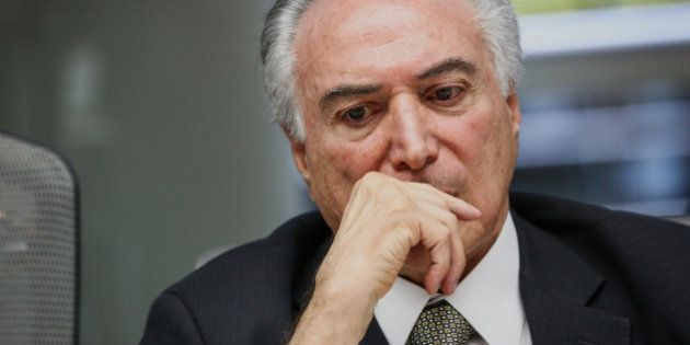 Michel Temer, president of Brazil, listens during an interview in New York, U.S., on Monday, Sept. 19,...