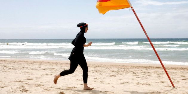 Twenty-year-old trainee volunteer surf life saver Mecca Laalaa runs along North Cronulla Beach in Sydney...