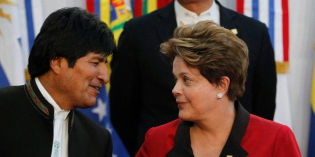 Bolivia's President Evo Morales (L) and Brazil's President Dilma Rousseff stand together during the official...