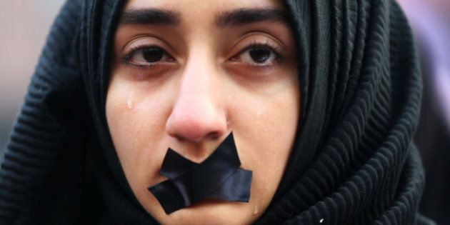 A Turkish student cries during a protest to show solidarity with trapped citizens of Aleppo, Syria, in...