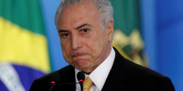 Brazil's interim President Michel Temer reacts during ceremony for the new rules of the