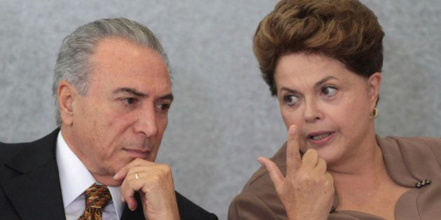 FILE - In this April 24, 2012 file photo, Brazil's President Dilma Rousseff, right, talks with Vice President...