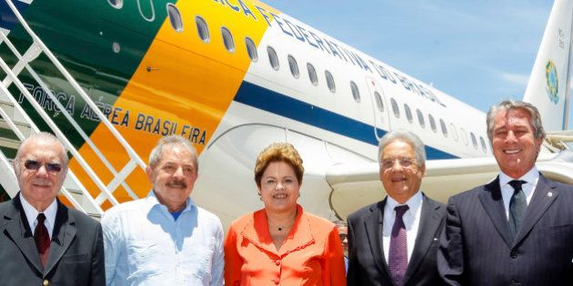Brazil's President Dilma Rousseff (C) poses for photos in Rio de Janeiro with former Brazilian Presidents...