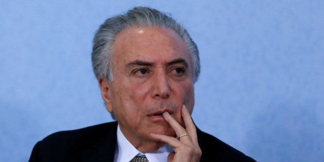 Brazil's interim President Michel Temer looks on during the Paralympics Flame torch relay launching ceremony...
