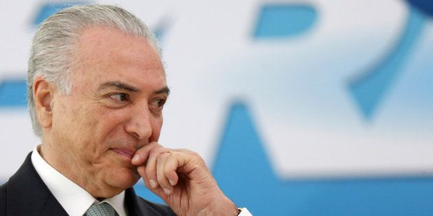 Brazil's President Michel Temer reacts during a ceremony at Planalto Palace in Brasilia, Brazil December...