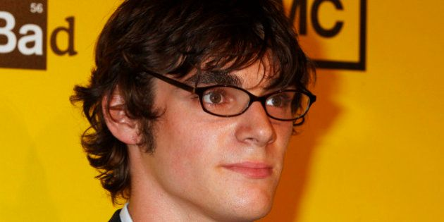Actor RJ Mitte, star of AMC's drama television series 'Breaking Bad', poses as he arrives for the premiere...