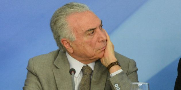 Brazilian President Michel Temer gestures during the announcement of new measures to stimulate the economy,...