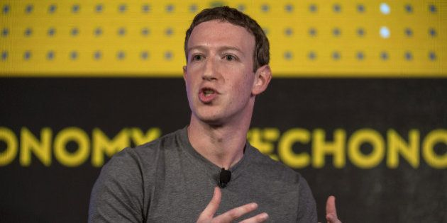 Mark Zuckerberg, chief executive officer and founder of Facebook Inc., gestures as he speaks during a...