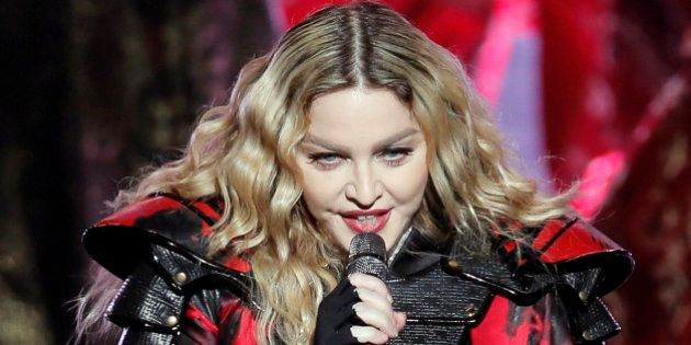 FILE - In this Feb. 20, 2016 file photo, Madonna performs during the Rebel Heart World Tour in Macau....