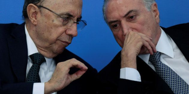 Brazil's Finance Minister Henrique Meirelles speaks with Brazil's interim President Michel Temer during...