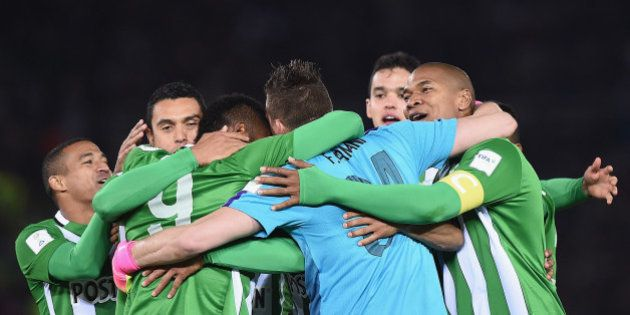 YOKOHAMA, JAPAN - DECEMBER 18: Alexis Henriquez (R) of Atletico Nacional celebrates with team mates victory...