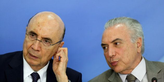 Brazil's Finance Minister Henrique Meirelles and Brazil's President Michel Temer attend the announcement...