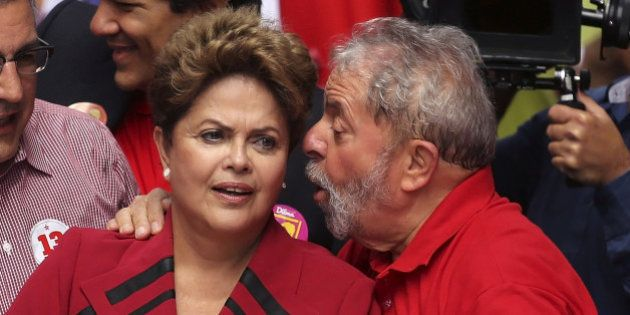 Brazil's President and Workers' Party (PT) presidential candidate Dilma Rousseff (L) talks with her predecessor...