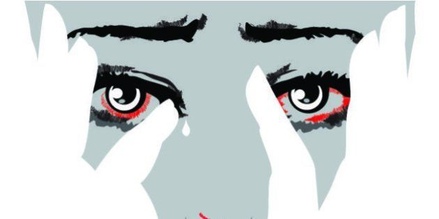 Unhappy woman cries covering face with hands. Eyes filled with tears. Stop violence against women concept....