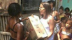 Sem alarde, Anitta visita Cidade de Deus e distribui cestas básicas e