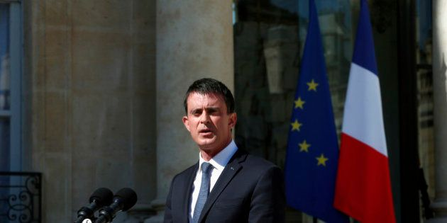 French Prime Minister Manuel Valls speaks to media after a security meeting at the Elysee Palace, in Paris, Friday, July 15, 2016. Prime Minister Valls said the government is declaring three days of national mourning after the attack in Nice. Speaking after an emergency meeting, Valls said the national mourning would begin Saturday. (AP Photo/Thibault Camus)